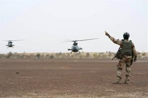 In this photo taken Monday, Jan. 28, 2013,  provided by the French Army Communications Audiovisual office, a French soldier directs helicopters near Timbuktu, north Mali.