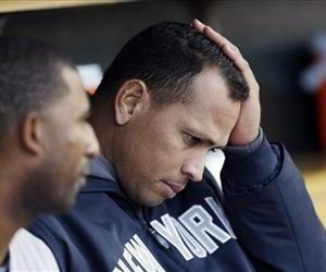 Alex Rodriguez watches from the dugout during Game 4 of the ALCS against the Detroit Tigers in Detroit, Oct. 18, 2012.