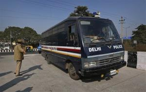 A Delhi police van, believed to be carrying the accused in the gang rape of a 23-year-old woman, enters a district court in New Delhi, India, Thursday, Jan. 10, 2013.