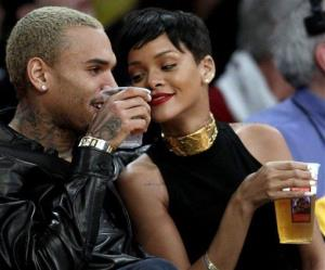 Entertainers Chris Brown, left, and Rihanna attend an NBA basketball game between the Los Angeles Lakers and New York Knicks in Los Angeles, Tuesday, Dec. 25, 2012.