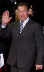 Arnold Schwarzenegger waves as he arrives for the European Premiere of The Last Stand at a central London cinema in Leicester Square, Tuesday, Jan. 22, 2013.