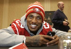 San Francisco 49ers cornerback Chris Culliver talks with teammates during a media availability Wednesday, Jan. 30, 2013, in New Orleans.