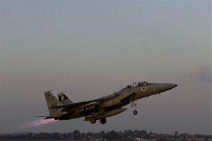 An Israeli air force jet fighter plane takes off from Tel Nof  air force base for a mission over Gaza Strip in central Israel, Monday, Nov. 19, 2012.