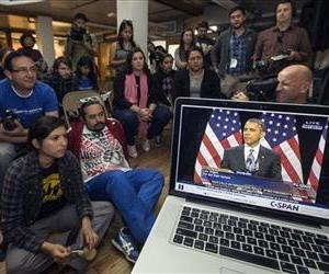 Members of the DREAM Team LA, a Los Angeles immigrants rights group, watch a live C-Span video stream of President Barack Obama in LA, Jan. 29, 2013.