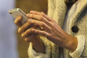 A woman uses her smartphone.