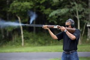 In this photo released by the White House Saturday, President Obama shoots clay targets at Camp David, Md., last August.
