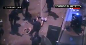 Egyptian riot police beat a naked man.