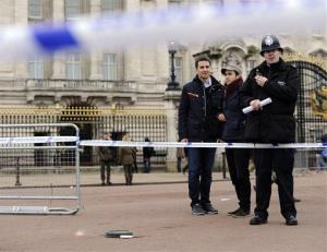 A cornered off area containing knives, a hat, and Taser wire outside Buckingham Palace after a man armed with two knives was stunned by police, Sunday Feb. 3, 2013.