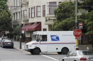 A US postal service truck drives through  the North Beach area of San Francisco, Wednesday, May 11, 2011.