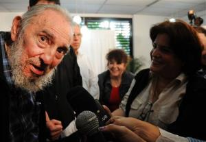 Fidel Castro talks to reporters at a polling station after casting his ballot in Havana yesterday.