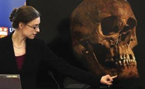 Jo Appleby, a lecturer in Human Bioarchaeology, who led the exhumation of the remains found during a dig at a Leicester car park, speaks at the university Monday Feb. 4, 2013.