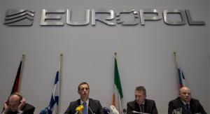 Officials from the European police agency Europol, elaborates on findings of a probe into match fixing during a press conference in The Hague, Netherlands, Feb. 4, 2013.