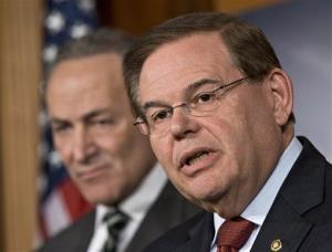 In this Monday, Jan. 28, 2013 file photograph, Sen. Robert Menendez, D-NJ, right, and Sen. Charles Schumer, D-NY, left, are shown at a news conference at the Capitol in Washington.