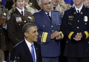 President Barack Obama is applauded prior to speaking about his gun violence proposals, Monday, Feb. 4, 2013, at the Minneapolis Police Department's Special Operations Center in Minneapolis.