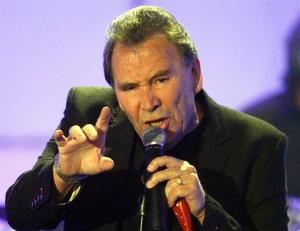 FILE - In this Tuesday, April 29, 2008 file photo Reg Presley, frontman of British rock group The Troggs, performs in a TV studio in Huerth,near Cologne, Germany during the recording of the 50th Chart Show - The Best Rock Classics. Rock star Reg Presley, lead singer of the...