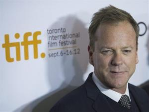 Kiefer Sutherland poses on the red carpet at the gala for the new movie The Reluctant Fundamentalist during the 37th annual Toronto International Film Festival in Toronto on Saturday, Sept. 8, 2012.