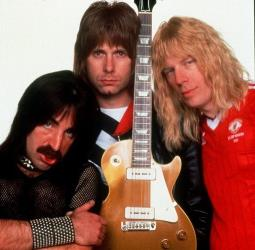This file photo shows Harry Shearer, left, Christopher Guest, center, and Michael McKean portray members of the spoof British band Spinal Tap.