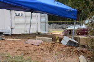 In this undated photo released by the FBI on Tuesday, a tent covers the bunker in Midland City, Ala.