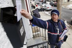 Letter carrier Kevin Pownall delivers mail in Philadelphia, Tuesday, March 2, 2010.