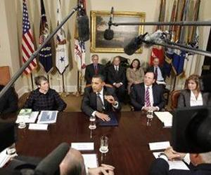 President Barack Obama, seated center, makes a statement on health care reform at the White House, in this May 12, 2009 file photo. Sally Jewel sits to his right.