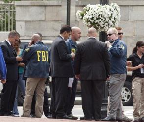 Washington police and FBI agents gather outside the Family Research Council in Washington on Aug. 15, 2012, after a security guard got shot.