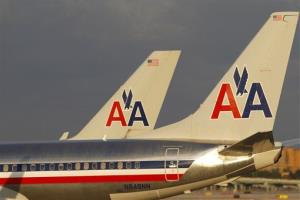 In this Thursday, Oct. 11, 2012 photo, the tail sections of two American Airlines passenger jets are shown as they taxi at Miami International Airport in Miami.