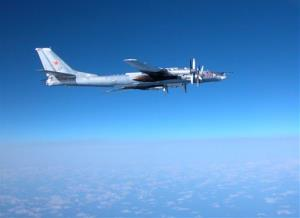 In this photo from Japan's Defense Ministry, a Tupolev 95 flies over the Izu island, just south of Tokyo, Saturday, Feb. 9, 2008, when the Russian air force bomber briefly violated Japanese airspace.