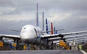 A line of Boeing 787 jets are parked nose-to-tail at Paine Field Tuesday, Feb. 5, 2013, in Everett, Wash.