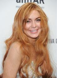 Actress Lindsay Lohan attends amfAR's New York gala at Cipriani Wall Street on Wednesday, Feb. 6, 2013 in New York.