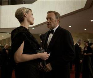 This image released by Netflix shows Robin Wright as Claire Underwood, left, and Kevin Spacey as US Congressman Frank Underwood in a scene from House of Cards.