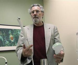 A doctor explains two different ultrasound devices at his clinic in Dallas, Texas, in this file photo. At left is a transvaginal ultrasound device and at right is a topical ultrasound.