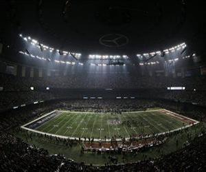 Fans and players wait for power to return in the Superdome, Feb. 3, 2013, during an outage in the second half of Super Bowl XLVII.