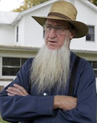 In this 2011 file photo, Sam Mullet Sr. stands in the front yard of his home in Bergholz, Ohio.
