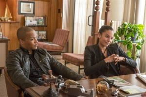 T.I., left, and Genesis Rodriguez in a scene from Identity Thief.