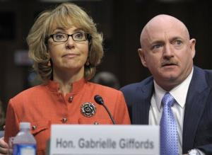 Gabrielle Gifford sits with her husband Mark Kelly, on Capitol Hill in Washington, Wednesday, Jan. 30, 2013.