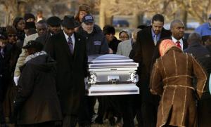 The remains of Hadiya Pendleton are taken to her final resting place at the Cedar Park Cemetery Saturday, Feb. 9, 2013, in Calumet Park, Ill.