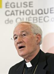 Cardinal Marc Ouellet responds to media at a news conference about his appointment by Pope Benedict XVI as Prefect of the Congregation for Bishops, Wednesday, June 30, 2010 in Quebec City, Canada.