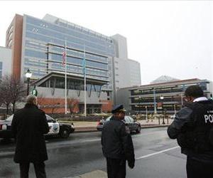 Police stand outside the New Castle County Courthouse, Monday morning, Feb. 11, 2013 in WIlmington, Del., after a man killed his estranged wife and two others at the courthouse.
