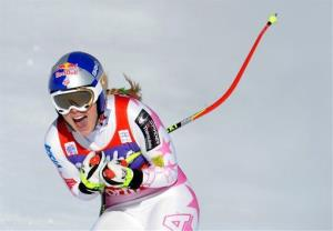 Lindsey Vonn, of the United States, celebrates at the finish area after winning an Alpine Ski World Cup women's downhill, in Cortina D'Ampezzo, Italy, Saturday, Jan.19, 2013.