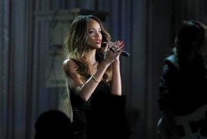 Rihanna performs on stage at the 55th annual Grammy Awards on Sunday, Feb. 10, 2013, in Los Angeles.