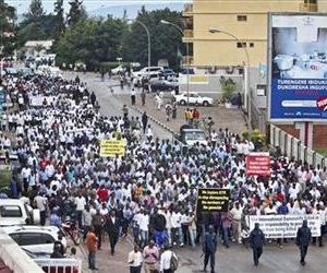 Genocide survivors, youths, and students march towards the offices of the International Criminal Tribunal of Rwanda (ICTR), in Kigali, Rwanda, Feb. 11, 2013.