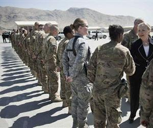 In this July 7, 2012, file photo, Secretary of State Hillary Rodham Clinton, right, greets troops before departing Kabul International Airport.