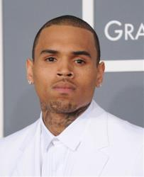 Chris Brown arrives at the 55th annual Grammy Awards on Sunday, Feb. 10, 2013, in Los Angeles.