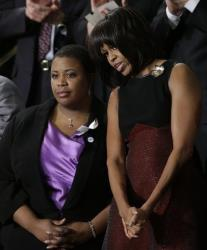 First lady Michelle Obama stands with Cleopatra Cowley-Pendelton, whose daughter was killed recently in Chicago.