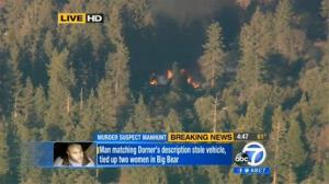In this image taken from video provided by KABC-TV, the cabin in Big Bear, Calif. where ex-Los Angeles police officer Christopher Dorner is believed to be barricaded inside is in flames Feb. 12, 2013.