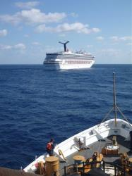In this image released by the U.S. Coast Guard on Feb. 11, 2013, the Coast Guard Cutter Vigorous patrols near the cruise ship Carnival Triumph in the Gulf of Mexico, Feb. 11, 2013.
