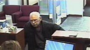 This Feb. 9 surveillance photo provided by the FBI shows 73-year-old Walter Unbehaun, an ex-convict from Rock Hill., SC, during a bank robbery in Niles, Ill.