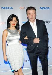 This Dec. 20, 2012 file photo released by Nokia shows Hilaria Thomas, left, and actor Alec Baldwin at the Nokia 30 Rock wrap party in New York.