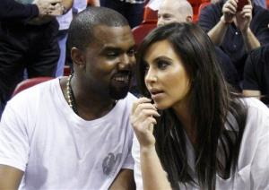 Kanye West talks to his girlfriend Kim Kardashian before a Miami Heat game in this file photo.