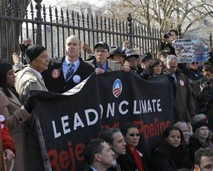 Civil rights protester Julian Bond, left, and Sierra Club Executive Director Michael Brune, second from left, gather with activists in front of the White House in Washington, Wednesday, Feb. 13, 2013.